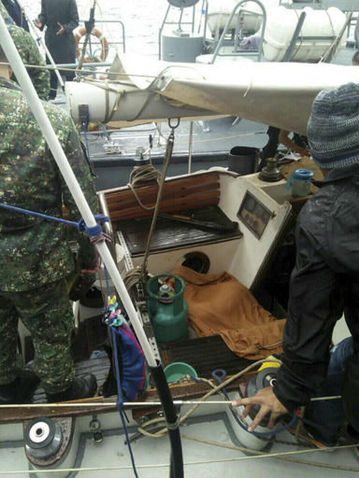 In this photo provided by Armed Forces of the Philippines Western Mindanao Command (WESMINCOM) and authorized for distribution by Army Maj. Filemon Tan Jr. Monday, Nov. 7, 2016, Philippine Navy crew board a yacht named