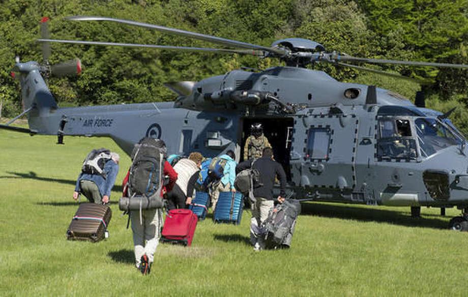 In this image provided by the Royal New Zealand Defense Force, tourists are evacuated by helicopter from Kaikoura following Monday's earthquake, in New Zealand, Tuesday, Nov. 15, 2016. New Zealand military officials said Tuesday that they had evacuated about 140 people by helicopter from a coastal town and were expecting that number to rise to 200 by the end of the day, as a major rescue operation unfolded following a powerful earthquake. (Royal New Zealand Defense Force via AP) Photo: Royal New Zealand Defence Force