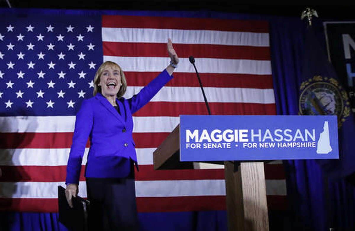 New Hampshire Democratic Senate candidate, Gov. Maggie Hassan waves to supporters during an election night rally in Manchester, N.H., early Wednesday, Nov. 9, 2016. Hassan is locked in a race to close to call with incumbent Republican Senator Kelly Ayotte. (AP Photo/Charles Krupa)