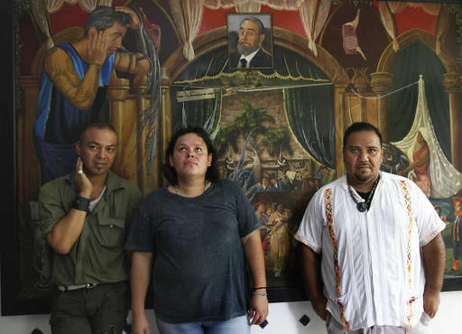 In this July 2, 2016 photo, Luis Edgardo Charnichart Ortega, left, Evanibaldo Larraga Galvan, center, and Juan Carlos Soni Bulos stand in Soni's terrace at his home, in Tanquian de Escobedo, San Luis Potosi, Mexico. The three men were detained by Mexican Marines, tortured and spent more than a year in prison on weapons and drug charges, without trial until a judge in March 2015 threw out the case. (AP Photo/Marco Ugarte) Photo: Marco Ugarte