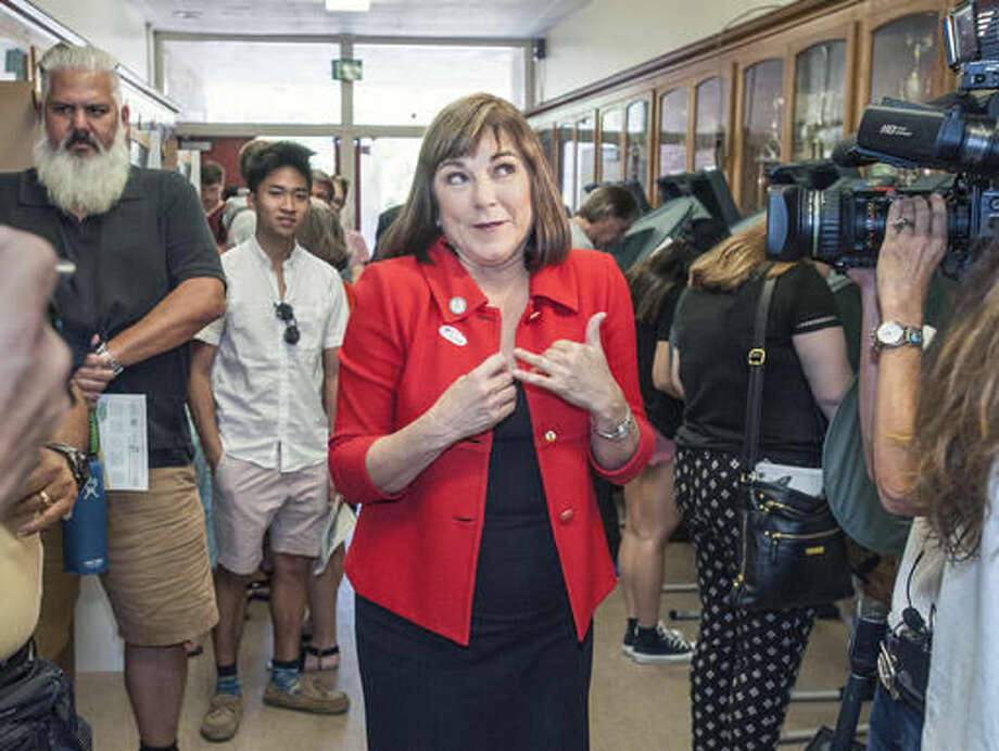 Rep. Loretta Sanchez, D-Orange, a Democratic candidate for U.S Senate. reacts to a comment about her blazer moments after voting on Election Day, Tuesday afternoon, Nov. 8, 2016, at Orange High School in Orange, Calif. (Mark Rightmire/The Orange County Register via AP) Photo: MARK RIGHTMIRE,
