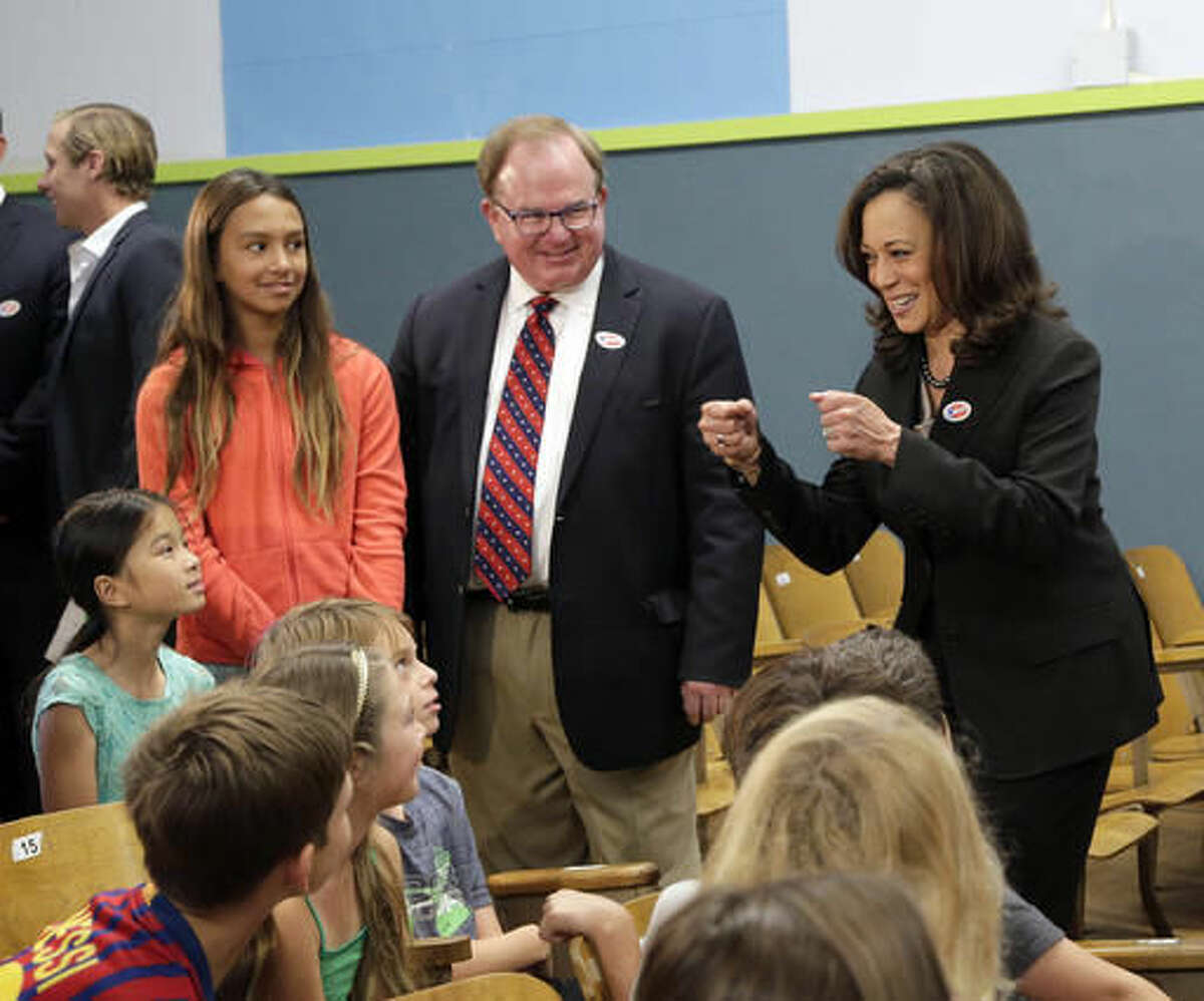 Democratic U.S. Senate candidate, Attorney General Kamala Harris cheers children after casting her ballot in Los Angeles, Tuesday, Nov. 8, 2016. (AP Photo/Nick Ut)