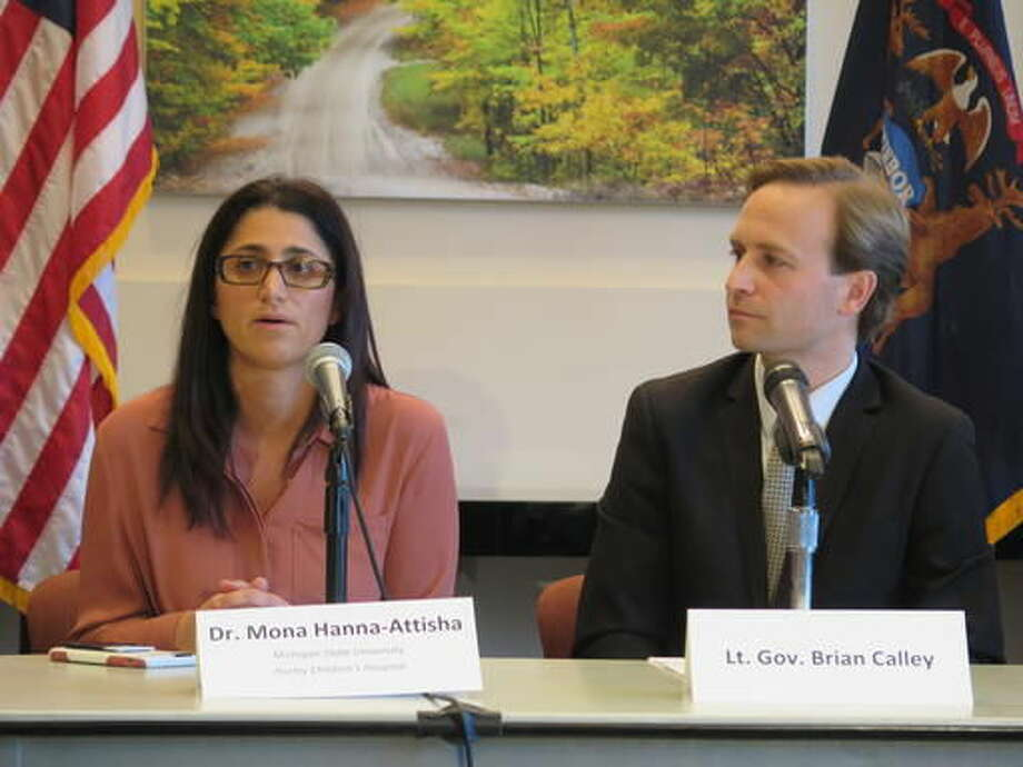 Dr. Mona Hanna-Attisha, who helped expose a lead crisis in the Flint, Mich., water system, and Lt. Gov. Brian Calley speak with reporters Thursday, Nov. 17, 2016, at a state building in Lansing, Mich. They sit on a board that recommended ways to eliminate child lead poisoning in Michigan. (AP Photo/David Eggert) Photo: David Eggert