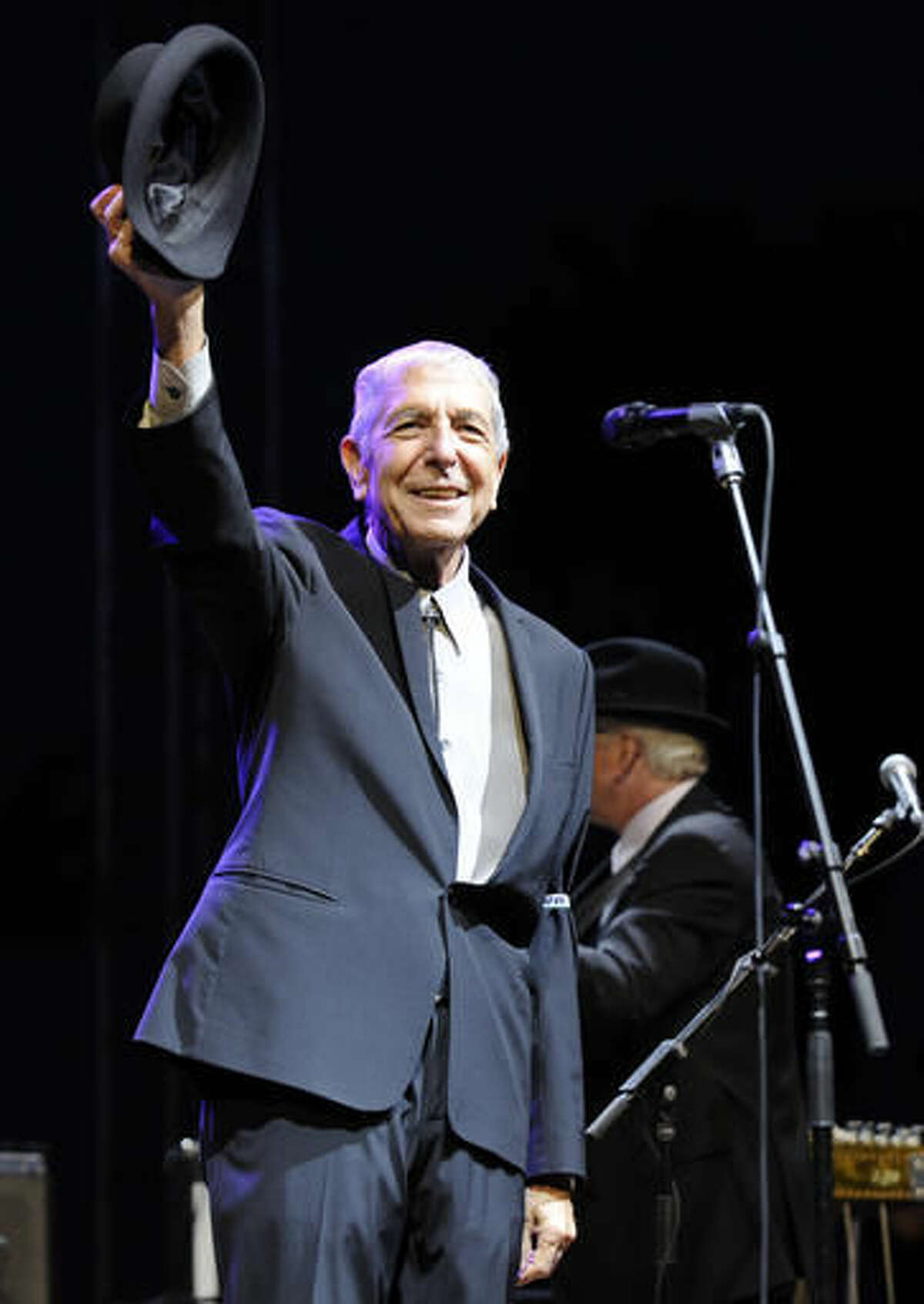 """CORRECTS DATE OF STATEMENT - FILE - In this April 17, 2009, file photo, Leonard Cohen salutes the crowd during his performance on the first day of the Coachella Valley Music & Arts Festival in Indio, Calif. Cohen, the gravelly-voiced Canadian singer-songwriter of hits like """"Hallelujah,"""" """"Suzanne"""" and """"Bird on a Wire,"""" has died, his management said in a statement Thursday, Nov. 10, 2016. He was 82. (AP Photo/Chris Pizzello)"""