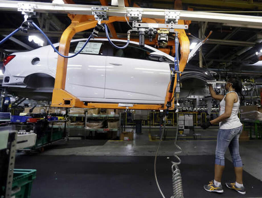A Buick Verano is assembled at General Motors' Orion Assembly plant in Orion Township, Mich. Photo: Carlos Osorio