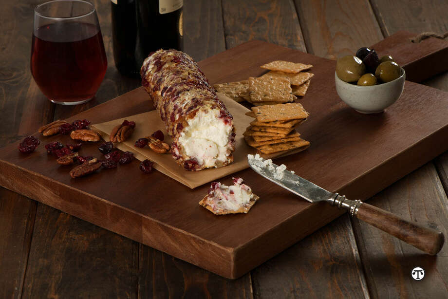 Delight holiday guests with this easy appetizer of goat cheese and Harvest Stone® crackers. (NAPS)