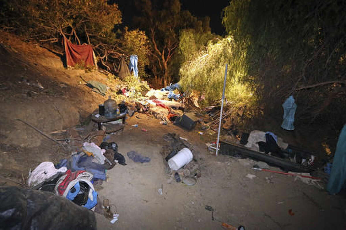 A homeless encampment where a car went off the side of the southbound lanes of Interstate 405 and landed, is seen near Sherman Way in the Van Nuys area of Los Angeles, Tuesday, Nov. 29, 2016. A woman who may have been homeless was killed and three people in the car were injured. (AP Photo/Reed Saxon)