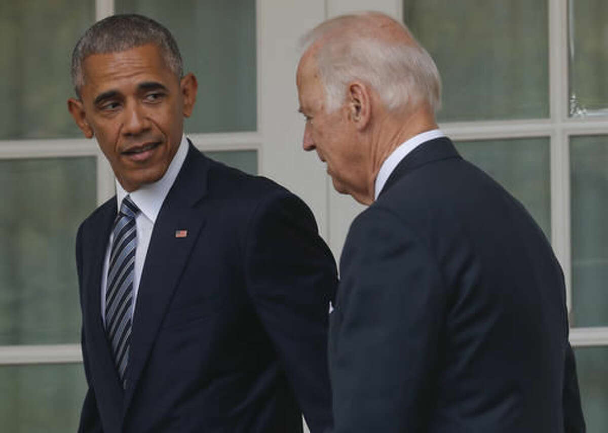 FILE - In this Nov. 9, 2016, file photo, President Barack Obama, accompanied by Vice President Joe Biden, walks back to the Oval Office of the White House in Washington, after speaking about the election in the Rose Garden. The potential awkwardness surrounding the transition from Democratic President Barack Obama's administration to one led by Republican President-elect Donald Trump has prompted the internet to imagine some amusing chats between Obama and Vice President Joe Biden.(AP Photo/Pablo Martinez Monsivais, File)