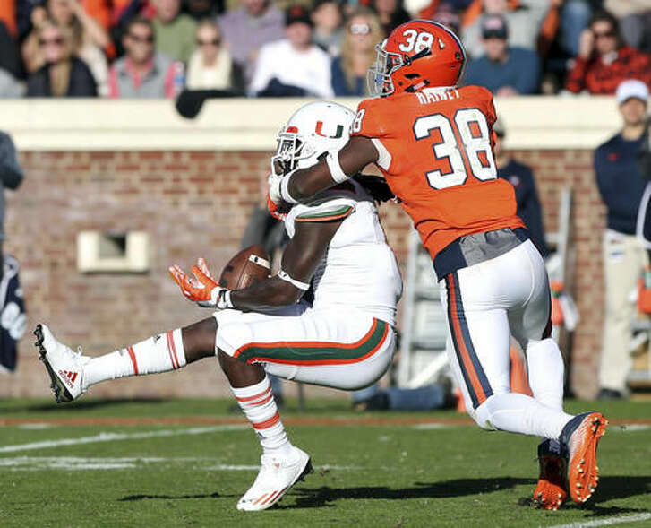 Miami wide receiver Malcolm Lewis (9) catches a pass in front of Virginia strong safety Kelvin Rainey (38) during the first half of an NCAA college football game in Charlottesville, Va. on Saturday, Nov. 12, 2016. (Ryan M. Kelly/The Daily Progress via AP)