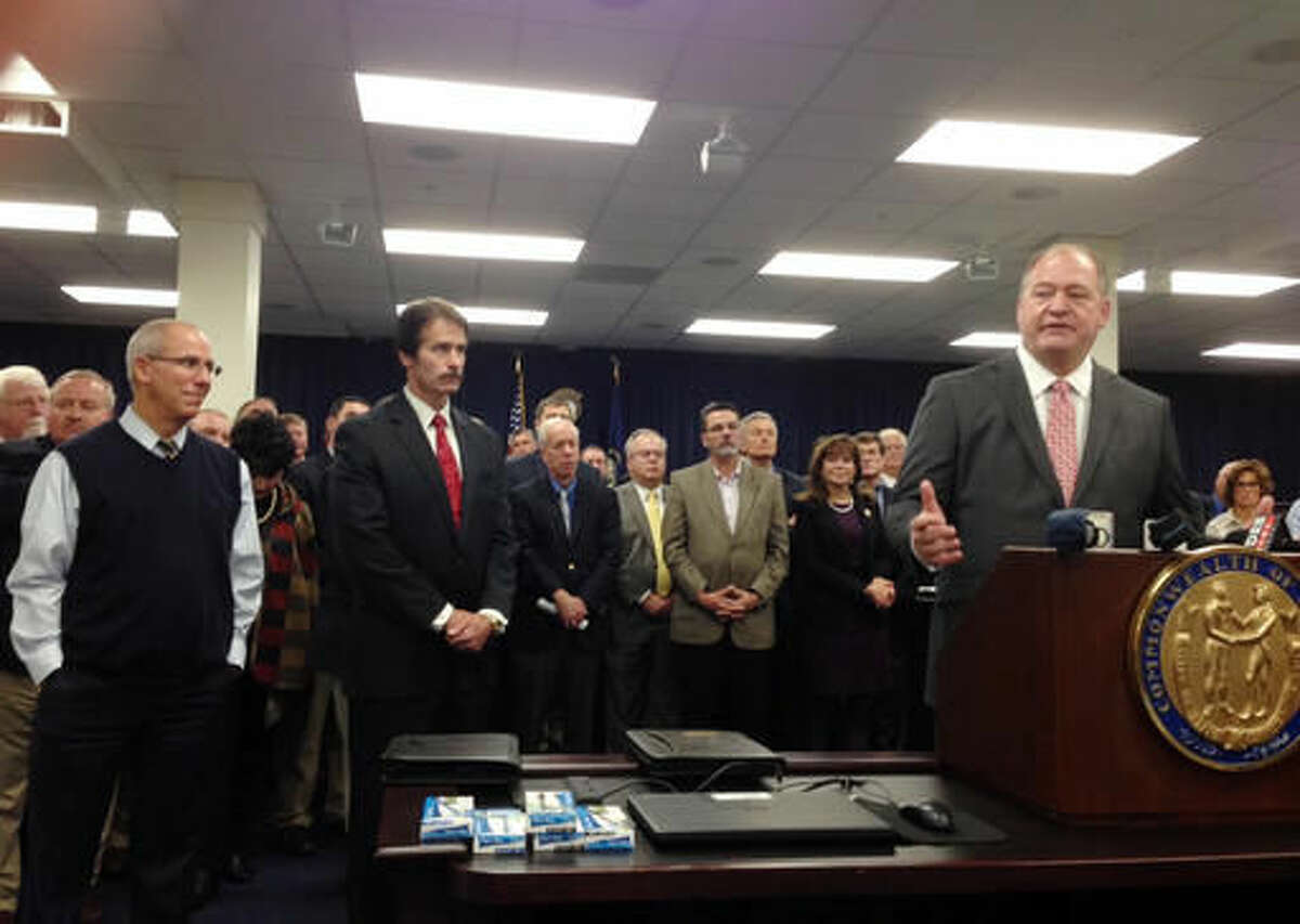 State Rep. Jeff Hoover, right, addresses the media after his Republican colleagues selected him as the next House speaker Thursday, Nov. 10, 2016, in Frankfort, Ky. Hoover called his unanimous selection the