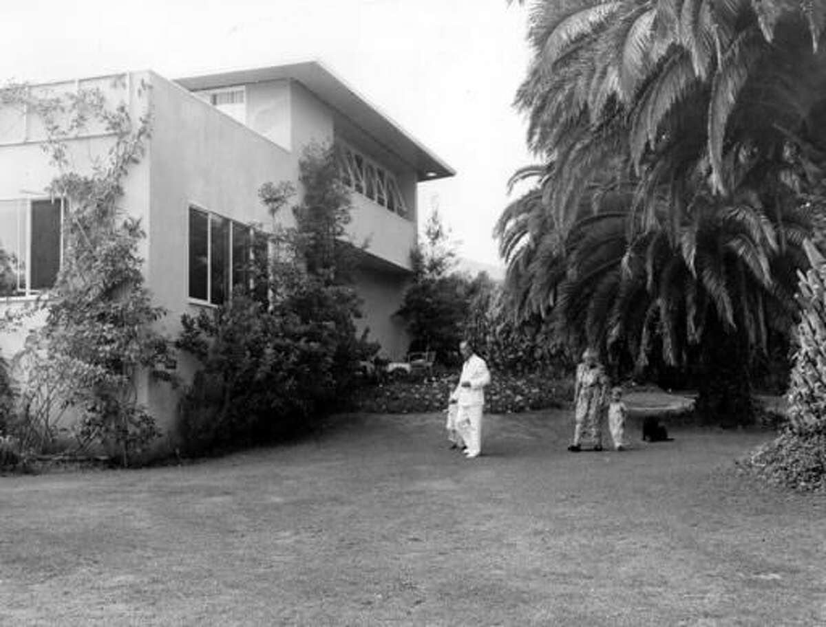 FILE - In this undated file photo, Thomas Mann, his wife Katia Mann and their two grandchildren stroll on the lawn of their Pacific Palisades home at Santa Monica, Calif. Germany has purchased a Los Angeles house once owned by Thomas Mann, averting demolition of the home where the Nobel Prize-winning novelist lived for a decade after fleeing the rise of Nazism. An online petition called on the German government to save the home in Pacific Palisades, describing it as a monument to exiles in California and resistance to the Nazi regime. It was bought for $13.25 million and officials say it will be renovated and used as an artist residency. (AP Photo, File)