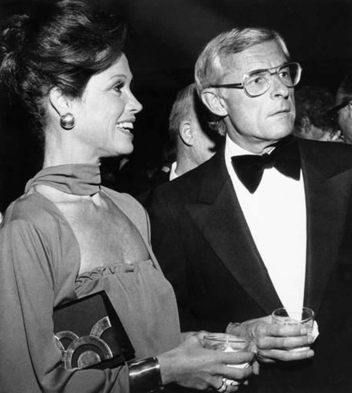 """FILE - In this Nov. 7, 1976, file photo, Mary Tyler Moore attends a reception in Los Angeles with her husband, Grant Tinker, before she was honored by the Hollywood chapter of the National Academy of Television Arts and Sciences for outstanding achievement in the industry. Tinker, who brought """"The Mary Tyler Moore Show"""" and other hits to the screen as a producer and a network boss, has died. Tinker died Monday, Nov. 28, 2016, at his home in Los Angeles, according to his son, Mark Tinker. (AP Photo/File)"""