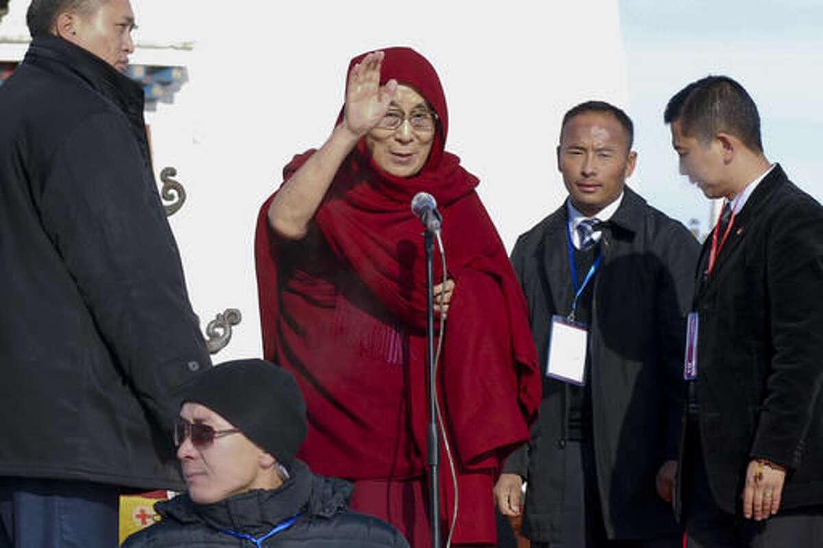 FILE - In this file photo taken Saturday, Nov. 19, 2016, Dalai Lama, center, waves as he arrives at the Janraiseg temple of Gandantegchinlen monastery to greet Mongolian people in Ulaanbaatar, Mongolia. Exiled Tibetan spiritual leader the Dalai Lama said Wednesday, Nov 23, 2016, he has