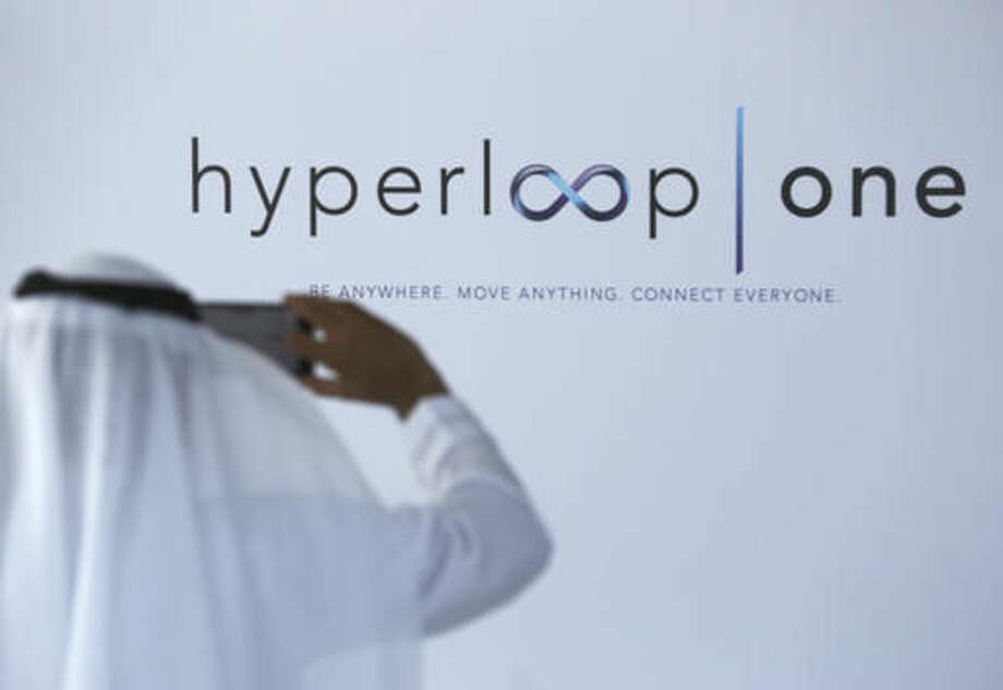 An Emirati takes a photograph of the Hyperloop One logo with his mobile phone in Dubai, United Arab Emirates, Tuesday, Nov. 8, 2016. The futuristic city-state of Dubai announced a deal on Tuesday with Los Angeles-based Hyperloop One to study the potential for building a line linking it to the Emirati capital of Abu Dhabi. (AP Photo/Jon Gambrell) Photo: Jon Gambrell