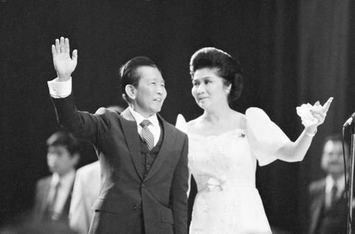 FILE - In this Sept. 26, 1982 file photo, Philippine President Ferdinand Marcos and First Lady Imelda Marcos appear at a rally in the Los Angeles Sports Arena. A multimillion-dollar trove of seized Impressionist art believed to have been owned by the regime of Philippine dictator Ferdinand Marcos has sat for five years in a climate-controlled New York warehouse, the subject of a bitter legal fight. At issue is whether the 50 works should go to thousands of victims of the now-dead dictator, to the current Filipino government or to the secretary to Imelda Marcos, who contends she was rightfully given some of the art as gifts. (AP Photo, File)
