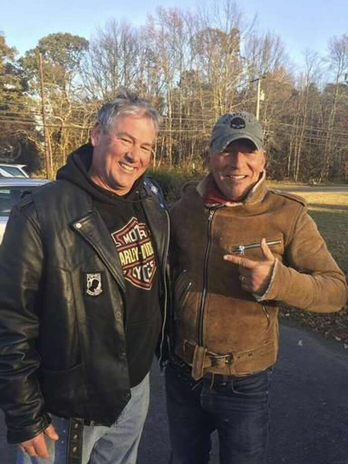 In this Friday, Nov. 11, 2016, photo provided by Ryan Bailey, Dan Barkalow, left, and Bruce Springsteen poses for a photo in Wall Township, N.J. Barkalow and a group from the Freehold American Legion was riding after a Veterans Day event Friday when they pulled over to help a stranded motorcyclist who turned out to be The Boss. (Ryan Bailey via AP) Photo: Ryan Bailey