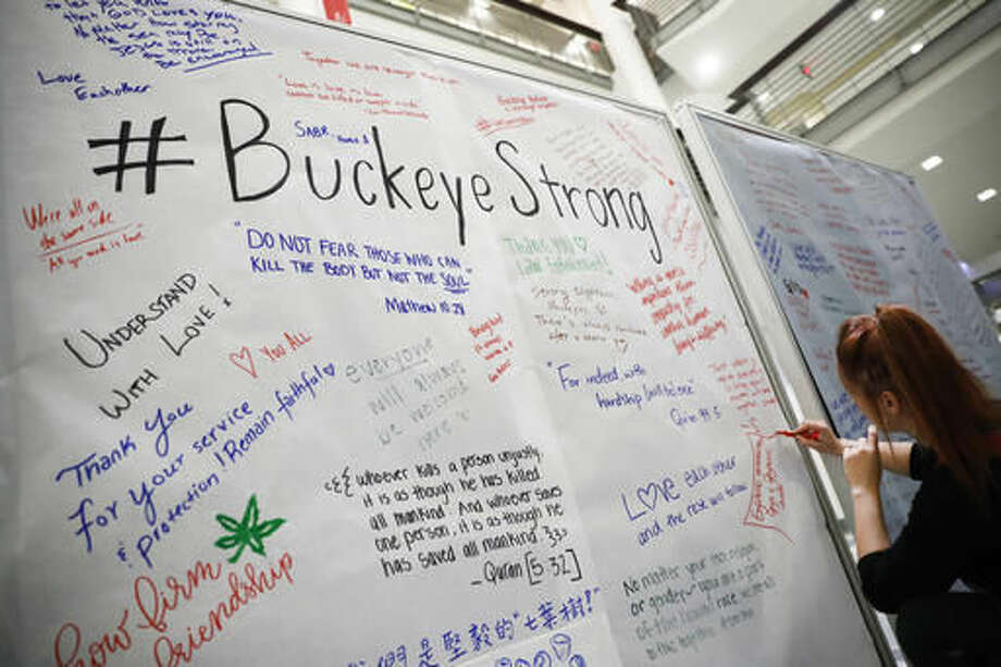 Student Ashley Greivenkamp signs a community message board at The Ohio State University student union Tuesday, Nov. 29, 2016, following an attack at on campus the previous day, in Columbus, Ohio. Investigators are looking into whether a car-and-knife attack at Ohio State University that injured several people was an act of terror by a student who had once criticized the media for its portrayal of Muslims. (AP Photo/John Minchillo) Photo: John Minchillo