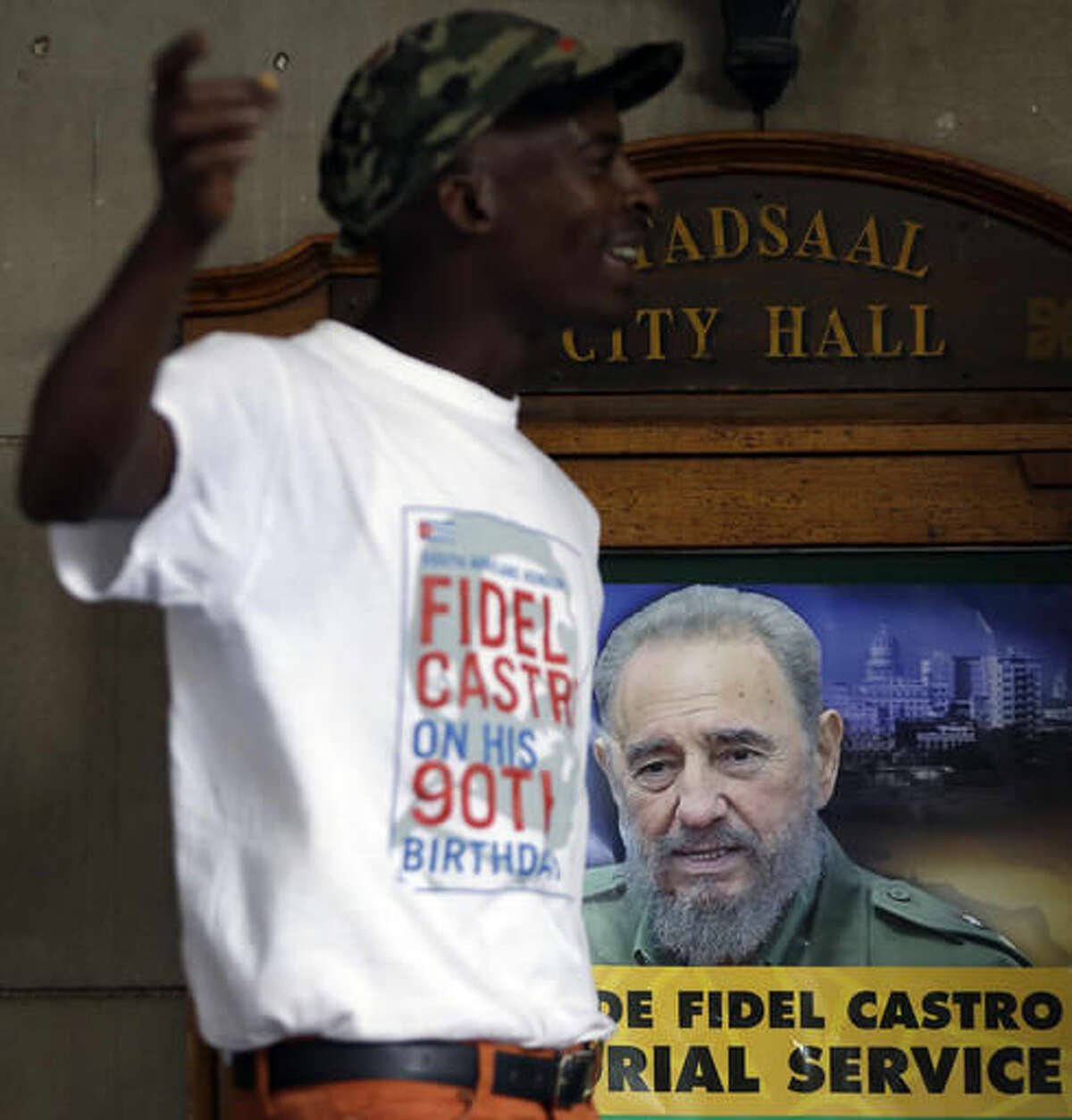 A man stands outside the venue hosting the memorial service for the late Cuban revolutionary leader Fidel Castro in Johannesburg, South AfricaWednesday, Nov. 30, 2016. Castro, who led a rebel army to improbable victory, embraced Soviet-style communism and defied the power of 10 U.S. presidents during his half century rule of Cuba, died Friday at age 90. (AP Photo/Themba Hadebe)