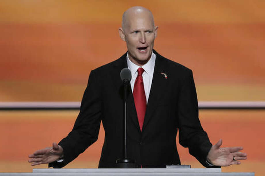 FILE - In this Wednesday, July 20, 2016, file photo, Florida Gov. Rick Scott speaks during the third day of the Republican National Convention in Cleveland. Scott may serve as a model and warning for President-elect Donald Trump. Both opposed the Republican establishment, spoke forcefully on cracking down in immigration and vowed to battle insiders in the capital. But Scott, after taking office, was forced to drop campaign promises, shift his stance on key issues, abandon much of his go-it-alone stance and deal with an ongoing divide with members of his own party. (AP Photo/J. Scott Applewhite, File) Photo: J. Scott Applewhite