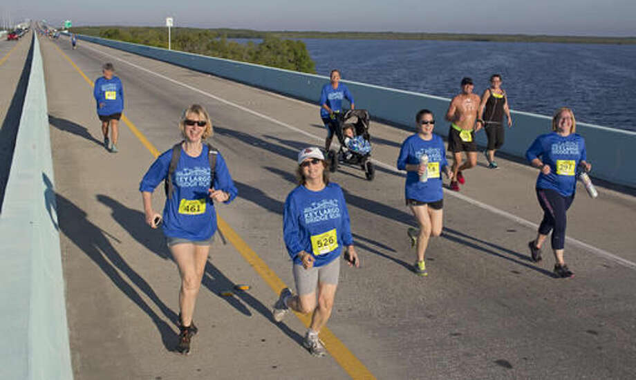 In this photo provided by the Florida Keys News Bureau, competitors in the 5k division of the Key Largo Bridge Run head to the finish line Saturday, Nov. 12, 2016. Some 465 registered entrants competed in 5k, 10k and half-marathon classes that took participants out and back over the 1.4-mile-long Jewfish Creek Bridge and land areas. (Bob Care/Florida Keys News Bureau via AP ) Photo: Bob Care