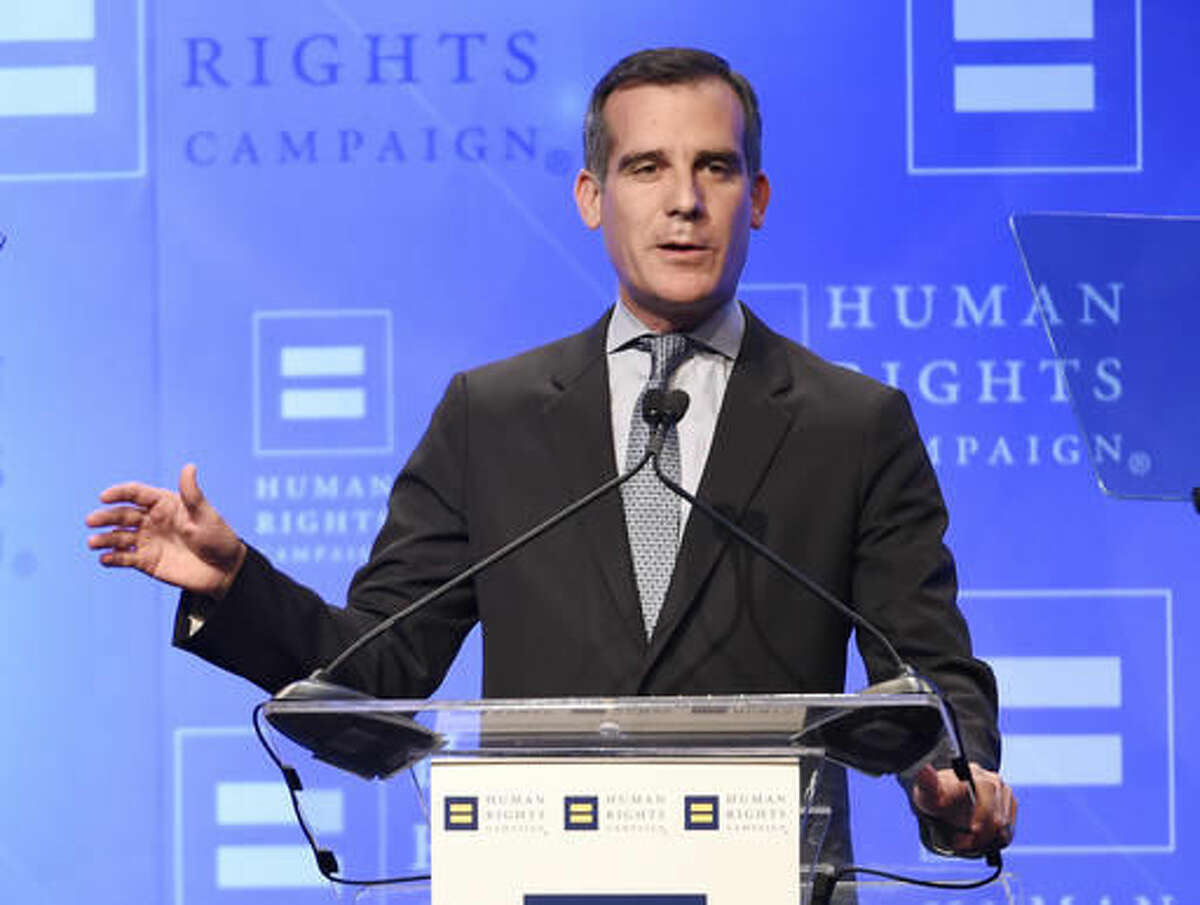 FILE - In this March 19, 2016 file photo, Los Angeles Mayor Eric Garcetti addresses the audience at the Human Rights Campaign 2016 Los Angeles Gala Dinner at the JW Marriott LA Live in Los Angeles. Garcetti and President-elect Donald Trump talked about immigration, infrastructure and the Olympics in their first phone call since the election. Garcetti's Press Secretary Connie Llanos says the Democrat Garcetti and the Republican Trump had a productive phone conversation on Wednesday, Nov. 23, 2016. (Photo by Chris Pizzello/Invision/AP, File)