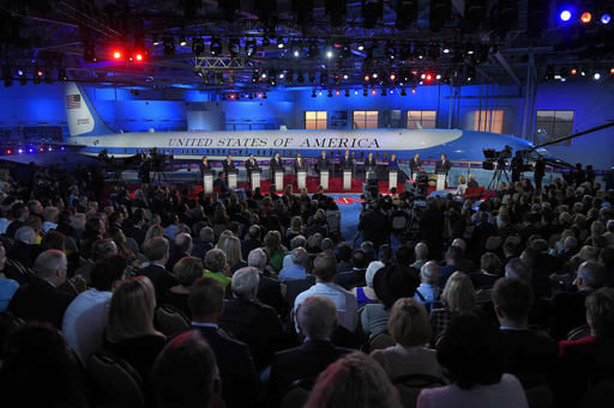FILE - In this Sept. 16, 2015, file photo, the GOP presidential candidates stand behind their podiums during the CNN Republican presidential debate at the Ronald Reagan Presidential Library and Museum in Simi Valley, Calif. Prominent Republicans and former White House aides were among those who celebrated the 25th anniversary of the Ronald Reagan Presidential Library in Southern California on Friday, Nov. 4, 2016. The sprawling center is the most visited presidential library in the nation. It has drawn an estimated 7.5 million visitors to features such as its Air Force One Pavilion, which holds the jet that carried seven presidents. (AP Photo/Mark J. Terrill, File)