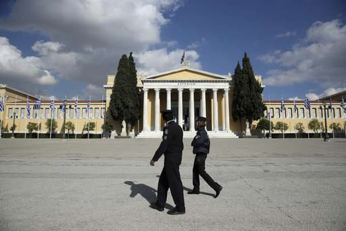 Police patrol outside Zappeio Conference Hall in Athens, Monday, Nov. 14, 2016. Thousands of police are to be deployed in Athens for draconian security measures during a two-day visit to Athens by President Barack Obama starting Tuesday. (AP Photo/Yorgos Karahalis)