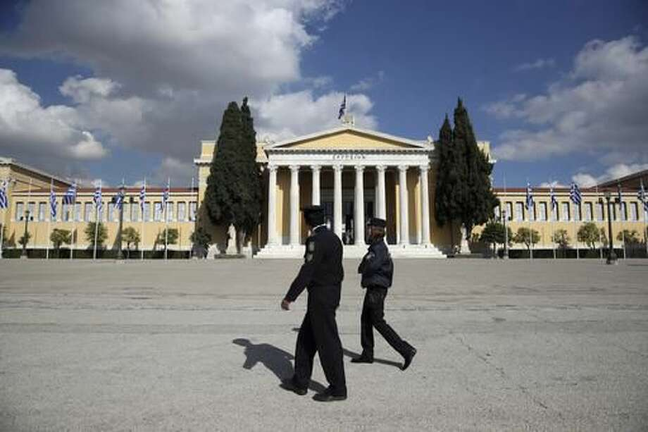 Police patrol outside Zappeio Conference Hall in Athens, Monday, Nov. 14, 2016. Thousands of police are to be deployed in Athens for draconian security measures during a two-day visit to Athens by President Barack Obama starting Tuesday. (AP Photo/Yorgos Karahalis) Photo: Yorgos Karahalis