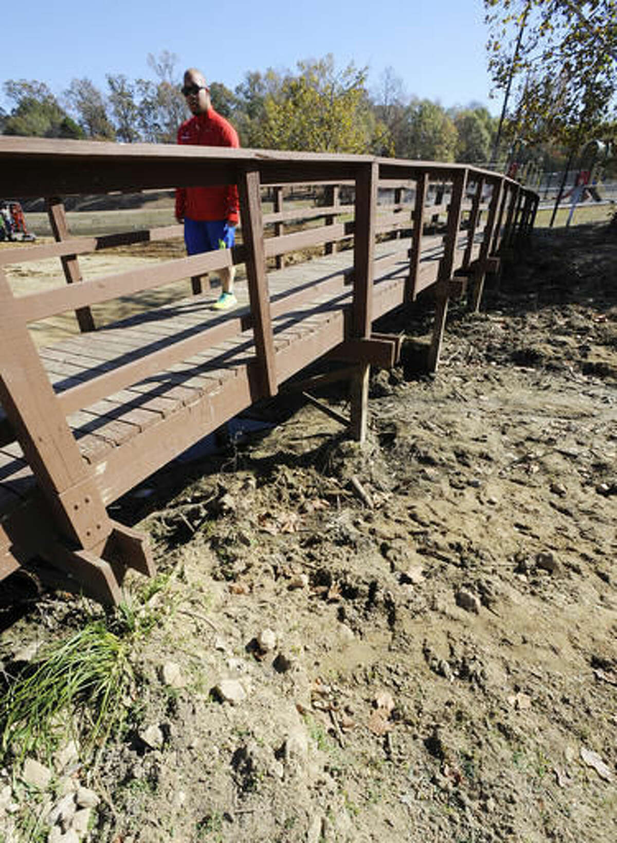Chris Smith walks over a pond dried up by a worsening drought in Helena, Ala., on Thursday, Nov. 17, 2016. Federal statistics show nearly 90 percent of the state is now in a severe drought. And the U.S. Drought Monitor shows 65 percent of the state is in an extreme or exceptional drought. (AP Photo/Jay Reeves)