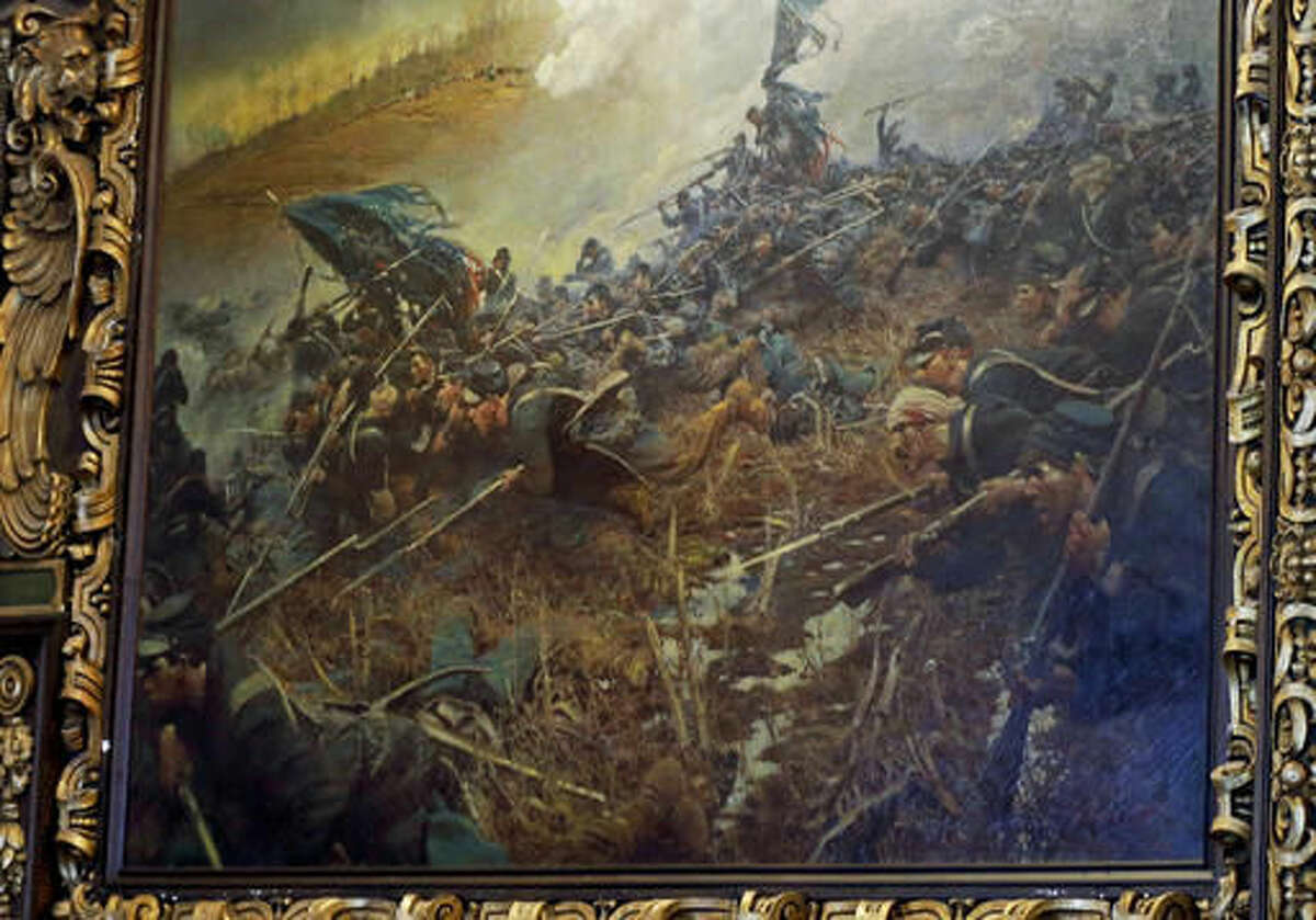 """FILE - In this March 6, 2014 file photo, Howard Pyle's 1906 painting, """"The Battle of Nashville,"""" depicting the Civil War battle, hangs in the governor's reception room at the Minnesota State Capitol in St. Paul, Minn. A commission overseeing restoration of the Capitol is torn over whether to bring back """"The Battle of Nashville"""" and other Civil War paintings that were previously displayed there. (AP Photo/Courtesy of the Minnesota State Capitol, File)"""