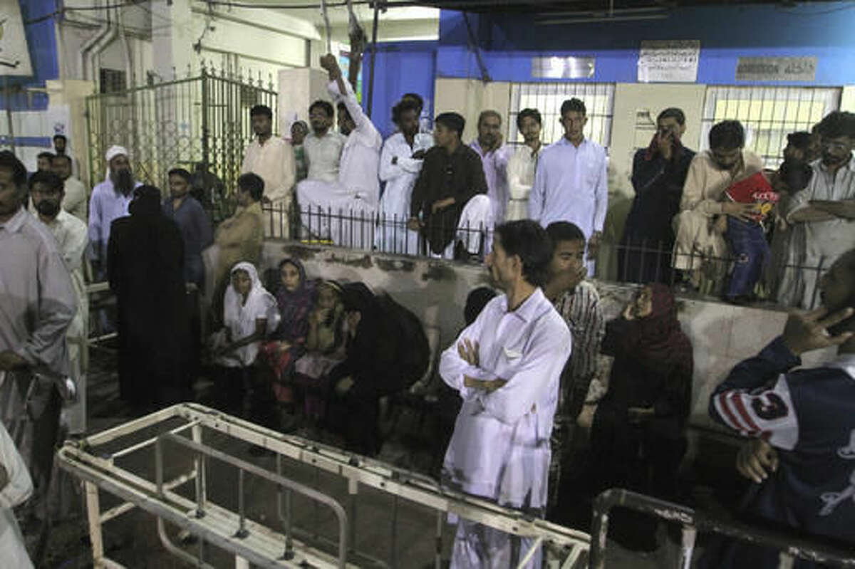 People gather outside an emergency ward of a local hospital after hearing news of a bomb blast at a Sufi shrine, in Karachi, Pakistan, Saturday, Nov. 12, 2016. Pakistani police say a bomb blast at a Sufi shrine has killed several people and wounded many others in the country's southwest. Sarfaraz Bugti, home minister for Baluchistan province, confirmed that the blast occurred with hundreds in attendance at the shrine of Sufi saint Shah Bilal Noorani. (AP Photo/Fareed Khan)
