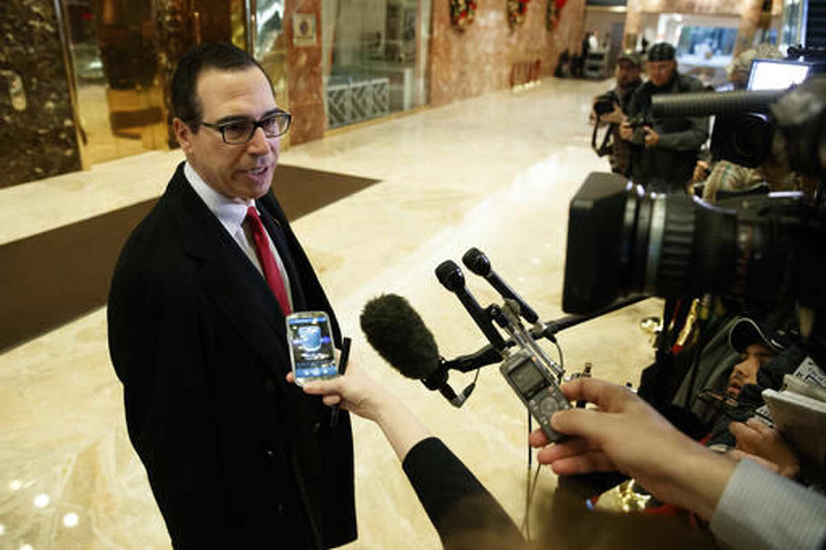 Steven Mnuchin, President-elect Donald Trump's nominee for Treasury Secretary, talks with reporters in the lobby of Trump Tower, Wednesday, Nov. 30, 2016, in New York. (AP Photo/Evan Vucci)