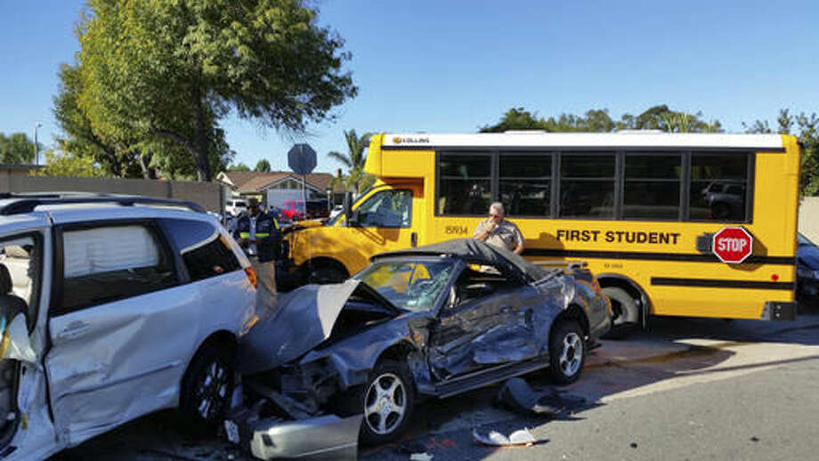 Emergency responders work the scene of an accident involving a school bus carrying students Tuesday, Nov. 29, 2016 in Lake Forest, Calif. The bus collided with three other vehicles according to Orange County Sheriff's Department Lt. Steve Gil. The students on the bus were not injured, said Orange County Fire Authority Capt. Larry Kurtz. (Nathan Percy /The Orange County Register via AP) Photo: Nathan Percy