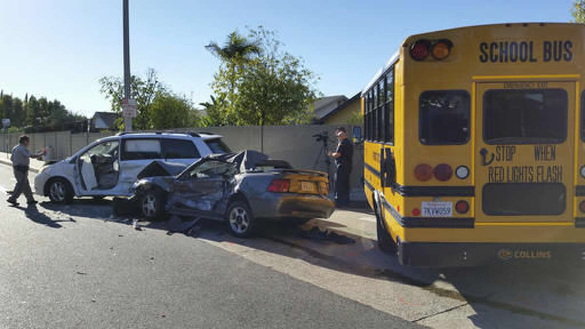 Emergency responders work the scene of an accident involving a school bus carrying students Tuesday, Nov. 29, 2016 in Lake Forest, Calif. The bus collided with three other vehicles according to Orange County Sheriff's Department Lt. Steve Gil. The students on the bus were not injured, said Orange County Fire Authority Capt. Larry Kurtz. (Nathan Percy /The Orange County Register via AP)