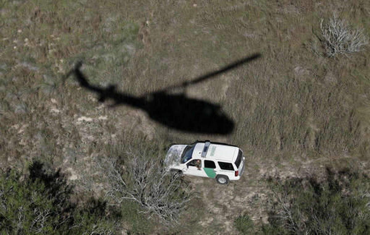In this Tuesday, Nov. 15, 2016, photo, a U.S. Customs and Border Patrol unit follows the trail of suspected illegal immigrants passing through the area near Edinburg, Texas. (AP Photo/Eric Gay)