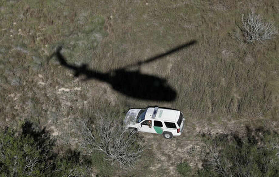 In this Tuesday, Nov. 15, 2016, photo, a U.S. Customs and Border Patrol unit follows the trail of suspected illegal immigrants passing through the area near Edinburg, Texas. (AP Photo/Eric Gay) Photo: Eric Gay
