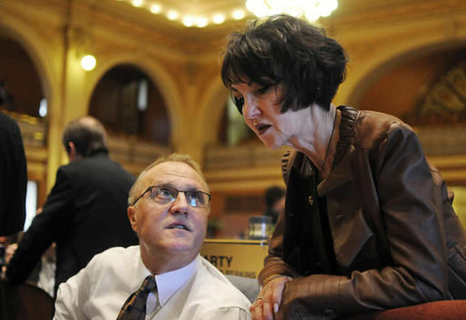 FILE - In this Feb. 10, 2016 file photo, South Dakota Secretary of Education Melody Schopp, right, speaks with Republican Rep. Dick Werner at the state Capitol in Pierre ahead of the House vote on a proposed half-cent sales tax increase for teacher's pay in South Dakota. The average teacher salary for the current budget year is projected at nearly $47,000, a jump of almost 12 percent, according to a new Department of Education survey. (AP Photo/James Nord, File) Photo: James Nord