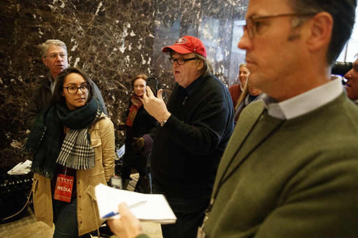 Filmmaker Michael Moore walks in the lobby of Trump Tower, Saturday, Nov. 12, 2016, in New York. (AP Photo/ Evan Vucci)