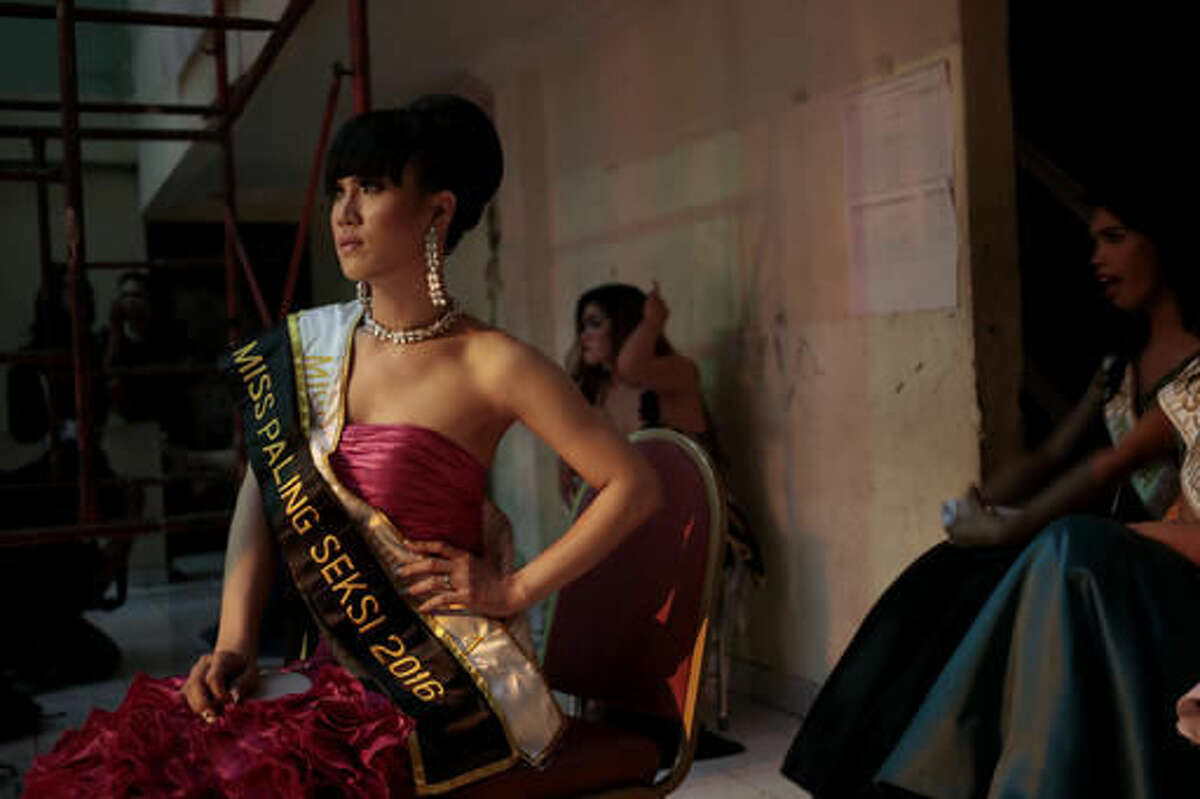 In this Friday, Nov. 11, 2016 photo, contestants wait backstage during the Miss Transgender Indonesia pageant in Jakarta, Indonesia. Transgender people and gay activists from across Indonesia have defied a wave of hatred against sexual minorities to crown a Miss Transgender at the national pageant held in absolute secrecy. (AP Photo/Dita Alangkara)
