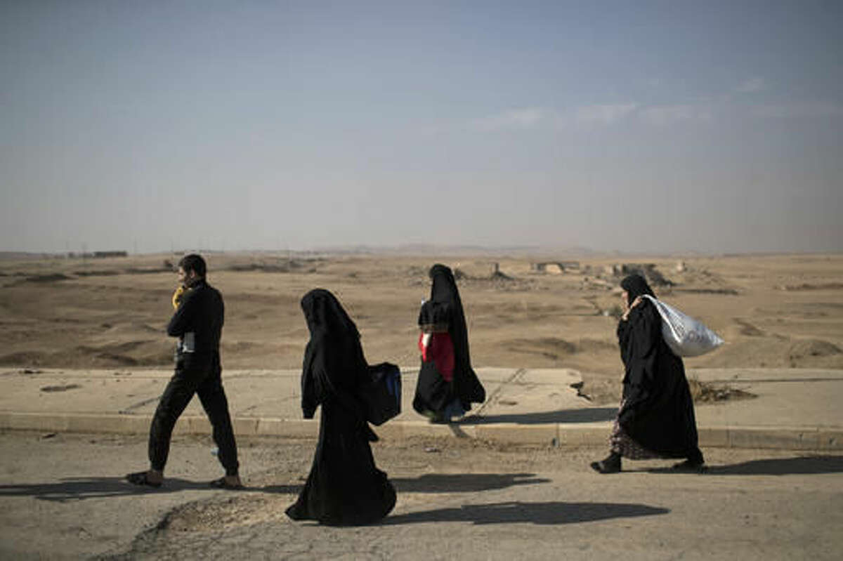 Displaced people leave their homes due to fighting, in Hamam al-Alil, south of Mosul, Iraq, Sunday, Nov. 6, 2016. The Mosul offensive has slowed in recent days as Iraqi forces have pushed into more densely populated areas, where they cannot rely as much on airstrikes and shelling because of the risk posed to civilians. (AP Photo/Felipe Dana)
