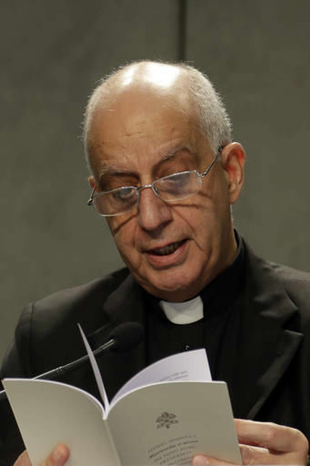 Monsignor Rino Fisichella reads an Apostolic Letter by Pope Francis during a press conference at the Vatican, Monday, Nov. 21, 2016. Declaring no sin beyond the reach of God's mercy, Pope Francis is allowing all priests to absolve women of the