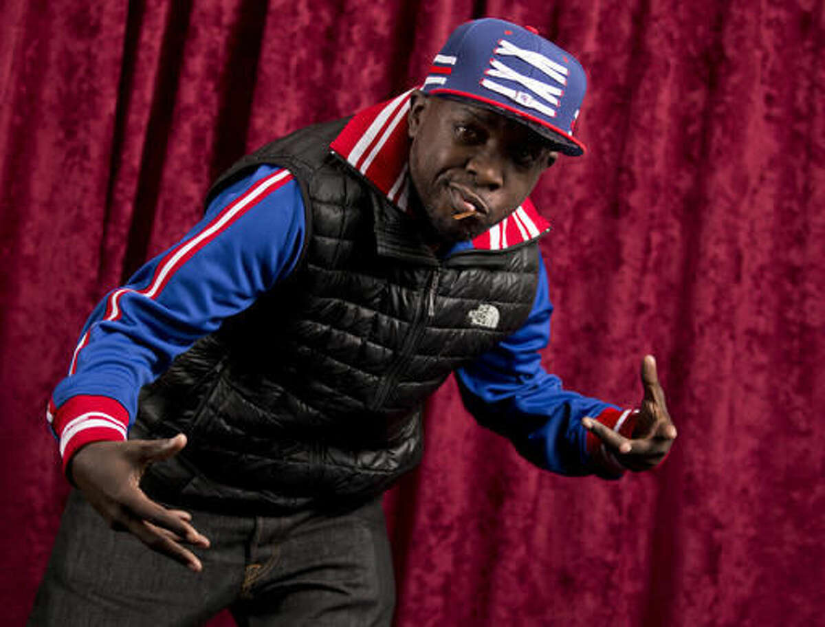 FILE - In this Nov. 12, 2015 file photo, Malik Isaac Taylor aka Phife Dawg, of A Tribe Called Quest, poses for a portrait at Sirius XM studios in New York. A New York City street corner is now named the Malik
