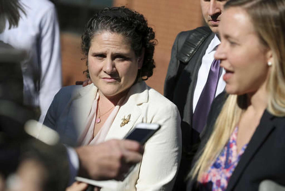 University of Virginia administrator Nicole Eramo, left, listens to attorney Libby Locke, right, speak with the media outside the federal courthouse in Charlottesville, Va., on Friday, Nov. 4, 2016. A federal jury on Friday found Rolling Stone magazine, its publisher and a reporter defamed Eramo in a discredited story about gang rape at a fraternity house of the university. (Ryan M. Kelly /The Daily Progress via AP)