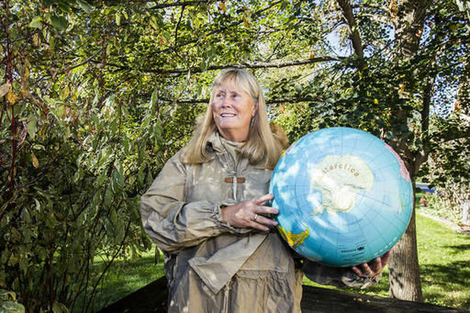 In this Thursday Oct. 13, 2016 photo, Betty Trummel poses for a portrait showing Antarctica on a globe in Crystal Lake, Ill. Trummel, a former elementary school teacher, will travel to Antarctica in December for three weeks. She's one of 78 women chosen from around the world to participate in Homeward Bound, an education and research expedition. This will be her fourth time visiting Antarctica. (Sarah Nader/Northwest Herald via AP) Photo: Sarah Nader