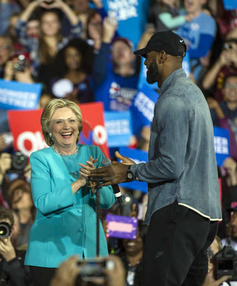 Democratic presidential candidate Hillary Clinton applauds Cleveland Cavaliers star LeBron James during a campaign rally at Cleveland Public Hall in Cleveland, Sunday, Nov. 6, 2016. (AP Photo/Phil Long) Photo: Phil Long