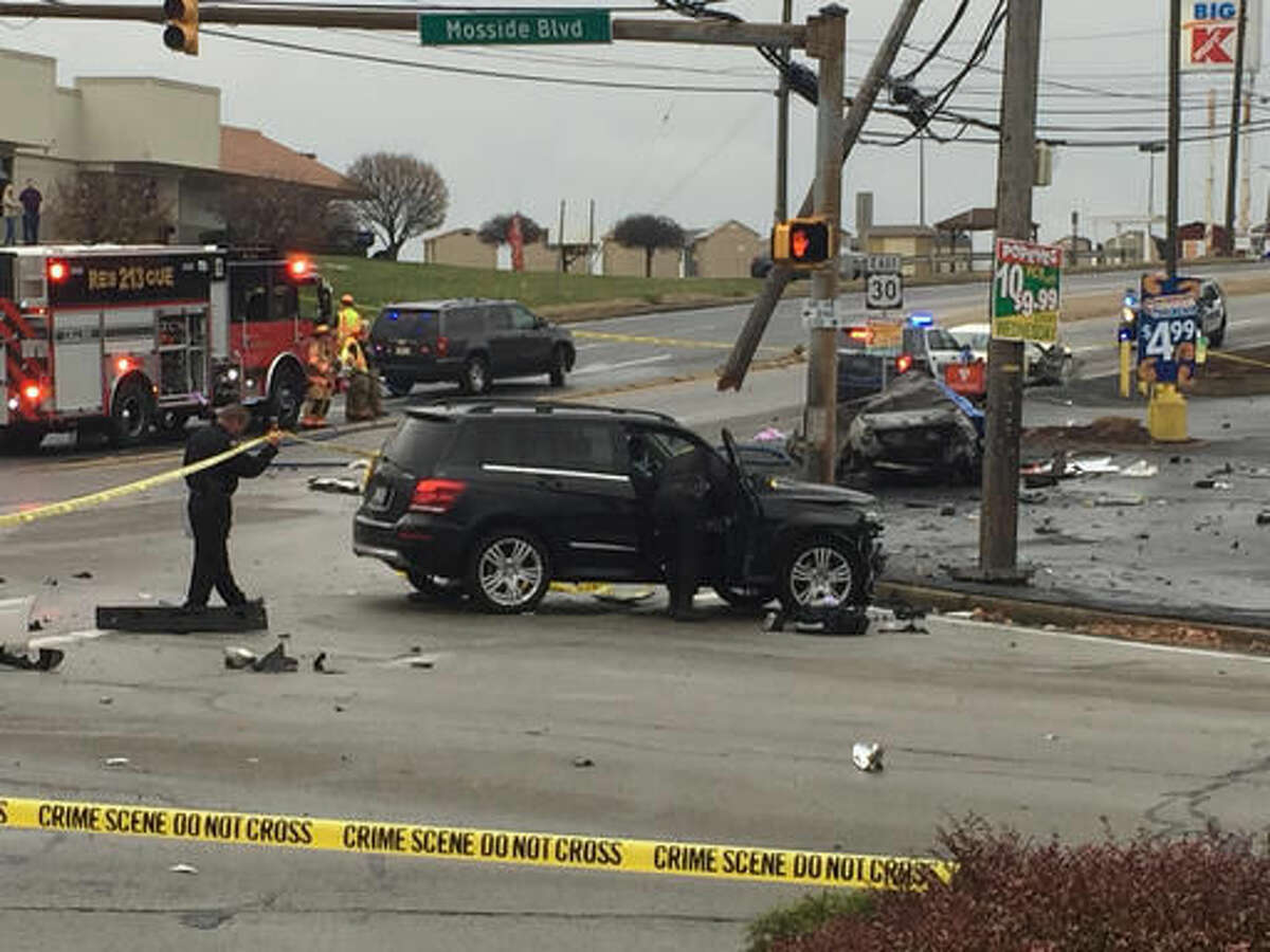 FILE - In this Nov. 24, 2016 file photo, police investigate the scene of a multi-vehicle crash at the intersection of Route 30 and Route 48, in North Versailles, Pa. Early indications are police didn't wrongly push a man who may have driven 100 mph to avoid officers before crashing into a car and killing a family of three on Thanksgiving, a prosecutor said Tuesday, Nov. 29. (Darrell Sapp/Pittsburgh Post-Gazette via AP, File)