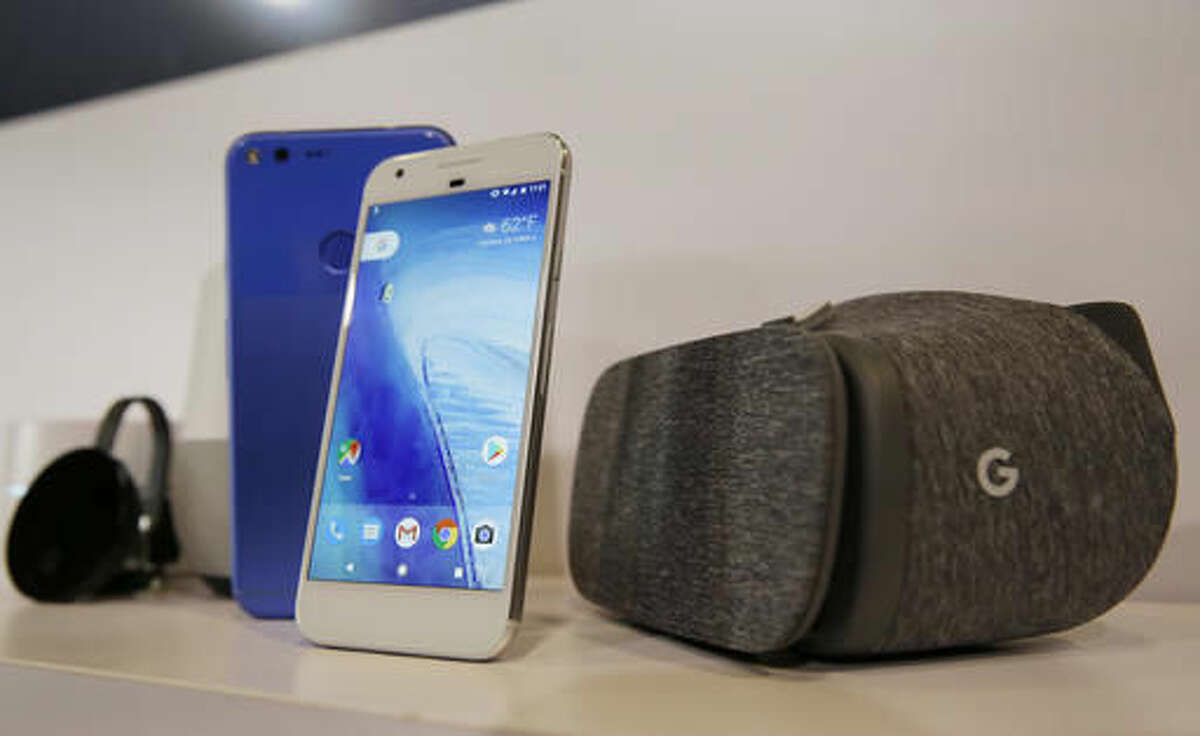 FILE- In this Oct. 4, 2016, file photo, the new Google Pixel phone is displayed next to a Daydream View virtual-reality headset, right, following a Google product event in San Francisco. Google is teaching a devastating lesson to some of its unwitting users: if you dare violate the company's policies, you can be abruptly cut off from your Gmail account and other digital services where vital information, indispensable documents and cherished photos are stored. Consumers who recently bought Pixel phones for a New Hampshire dealer are suffering through that harsh punishment after the internet company detected online purchases that violated its terms of service. (AP Photo/Eric Risberg, File)