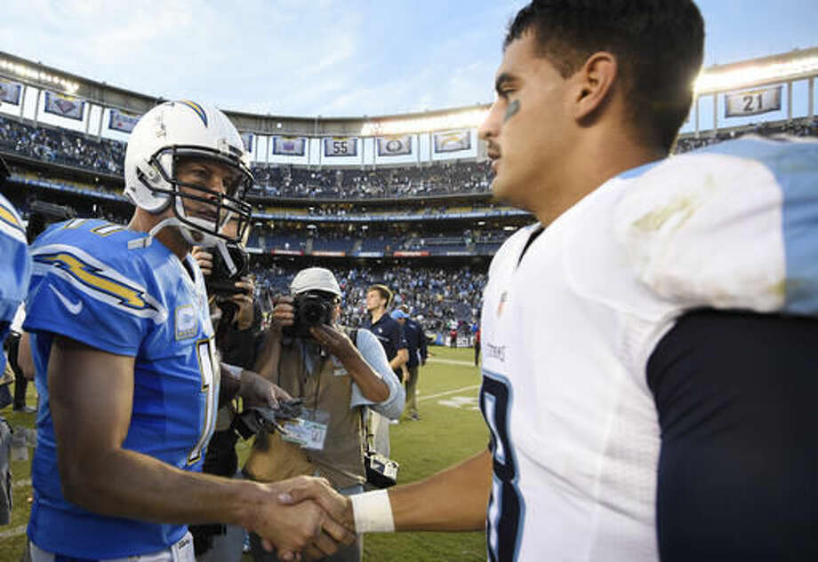 San Diego Chargers quarterback Philip Rivers, left, and Tennessee Titans quarterback Marcus Mariota, right, shake hands after an NFL football game Sunday, Nov. 6, 2016, in San Diego. The Chargers won. (AP Photo/Denis Poroy) Photo: Denis Poroy