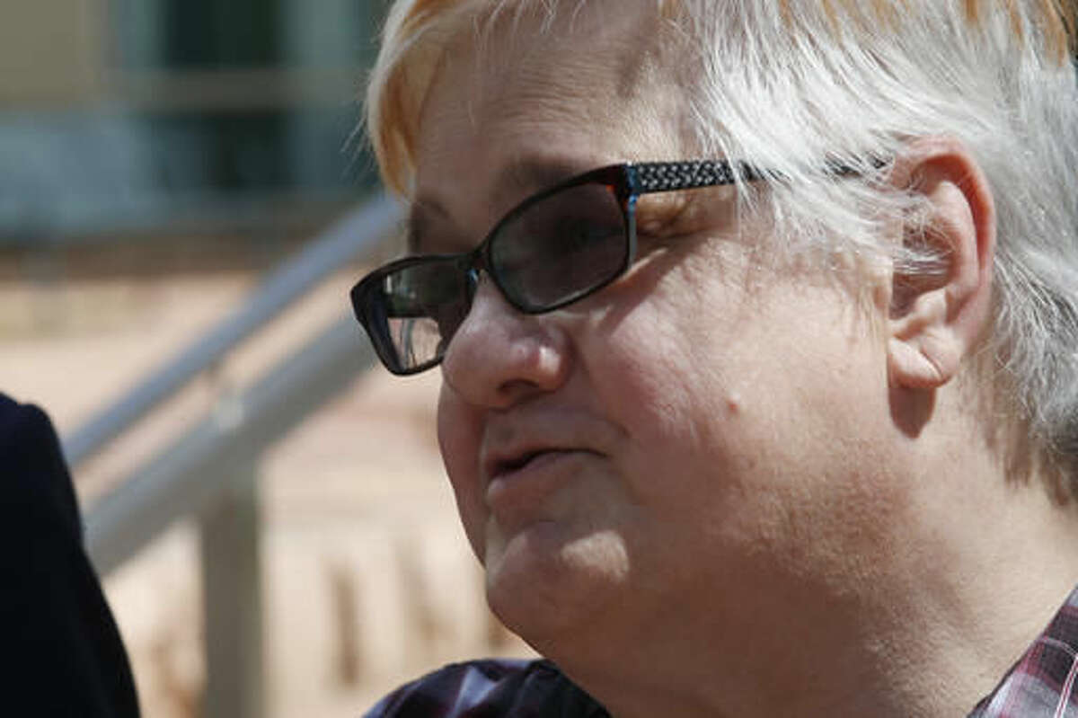 FILE - In this July 20, 2016, file photo, Dana Zzyym, of Fort Collins, Colo., talks about the arguments in a hearing on Zzyym's lawsuit outside the U.S. Federal Courthouse in Denver. Zzyym, who was born with ambiguous sex characteristics, claims that requiring people to designate their sex to get a passport is discriminatory. On Tuesday, Nov. 22, the district court ruled that the U.S. State Department violated federal law when it denied a passport to Zzyym, who is intersex. (AP Photo/David Zalubowski, file)