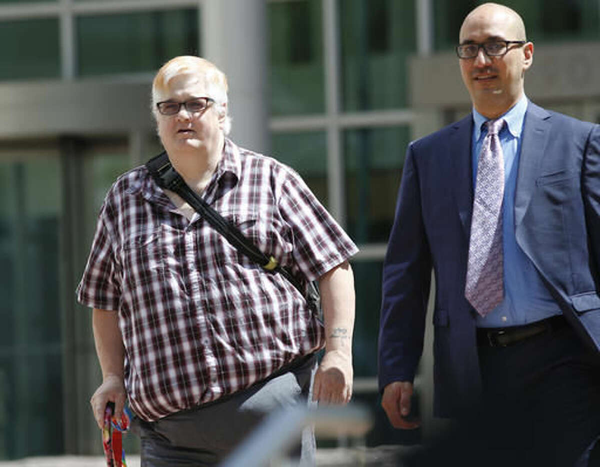 FILE - In this July 20, 2016, file photo, Dana Zzyym, of Fort Collins, Colo., left, and Paul D. Castillo, staff attorney of the South Central regional office of Lambda Legal, emerge after a hearing on Zzyym's lawsuit in Denver. Zzyym, who was born with ambiguous sex characteristics, claims that requiring people to designate their sex to get a passport is discriminatory. On Tuesday, Nov. 22, the district court ruled that the U.S. State Department violated federal law when it denied a passport to Zzyym, who is intersex, because Zzyym could not accurately choose either male or female on the application form. (AP Photo/David Zalubowski, file)